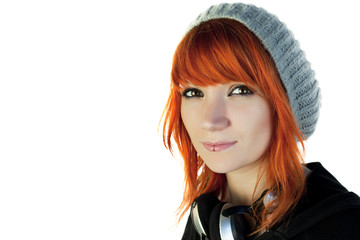 Redhead young woman with a cap and headphones