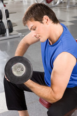 Man exercising with barbells