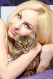 Woman cuddling cat poster