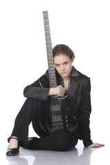 Seated girl with a black electric bass guitar