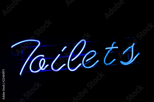 Blue neon toilets sign
