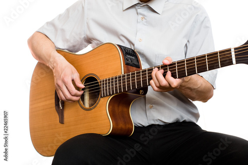 man plays guitar