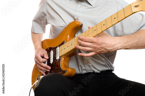 man plays electric guitar