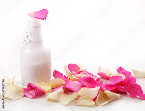bottle and rose petals
