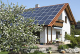 Family home with solar moduls poster