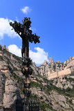 Monumental cross sculpture and Montserrat monastery (Catalonia, poster