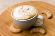fresh cappuccino in the Cup with Cookies