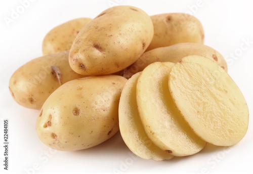 Yellow potatoes on a white background
