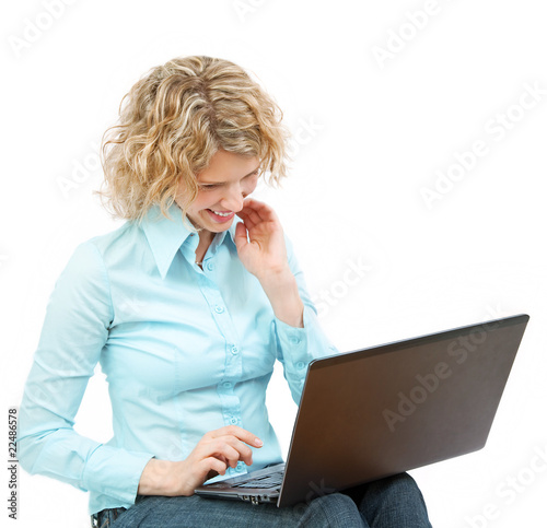Young woman with a laptop - isolated on white.