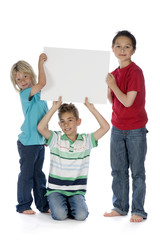 three boys with a sign
