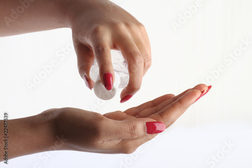 Using hand sanitizer - Hygiene concept