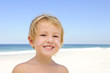 cute child with sunscreen  at the beach