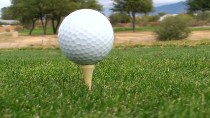 Golf ball on tee - HD