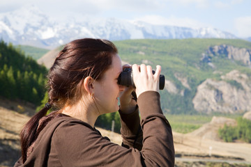young women looking through binocular