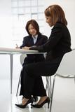 Businesswomen at desk