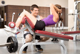 Loving couple in a gym