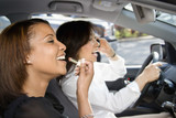 Women friends in car.