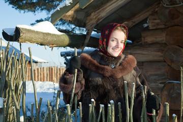 girl in fur coat against  snow landscape