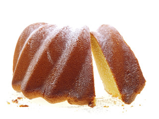 sliced bundt cake on white background
