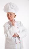 Expert senior female chef poster