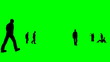 Silhouettes talking together against a green background