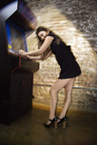 Girl playing arcade game poster