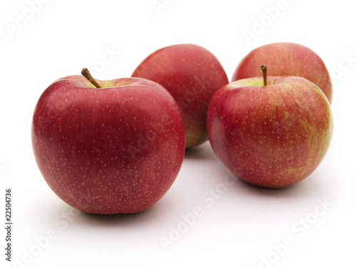 Some apples on a white table
