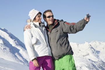 Young couple in ski wear taking self portrait