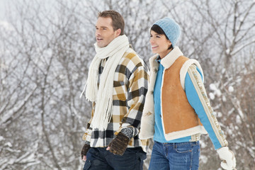 Young couple walking in snow