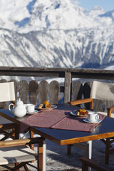 Breakfast table in a restaurant terrace, Courchevel, Alps, France