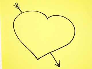 Heart with arrow drawn on a post-it note
