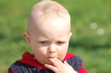 Child with finger in mouth
