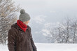Young man in winter clothes looking back