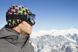 Portrait of young man with ski goggles, profile