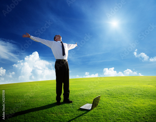 Leinwanddruck Bild happy young businessman on spring field