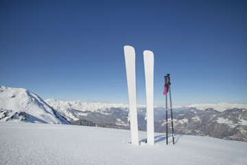 Skis and ski poles stuck in the snow