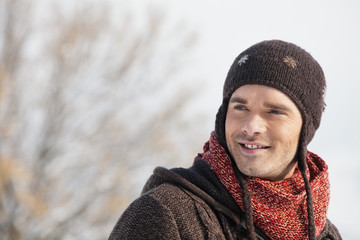 Portrait of young man in winter clothes