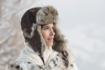 Young woman in winter clothes looking at camera