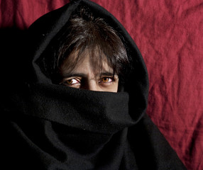 Woman's face covered by burka