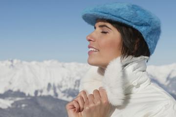 Young woman enjoying winter sun