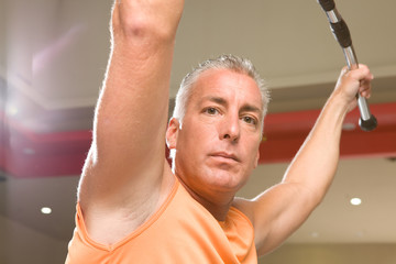 Mature man working on triceps