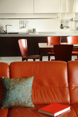 red sofa and interior of a kitchen