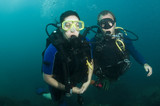 two scuba divers on a dive poster