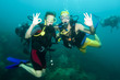 two scuba divers on a dive