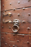 Scary door knocker in Volterra, Tuscany, Italy