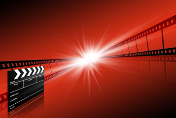 clap board ant film strip on red background