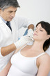 young  woman receiving an injection of botox from a doctor