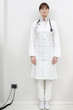 portrait of a young caucasian woman doctor standing