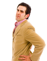 A young business man with a backache, isolated on white backgrou