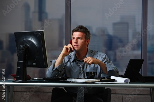Businessman on call working overtime